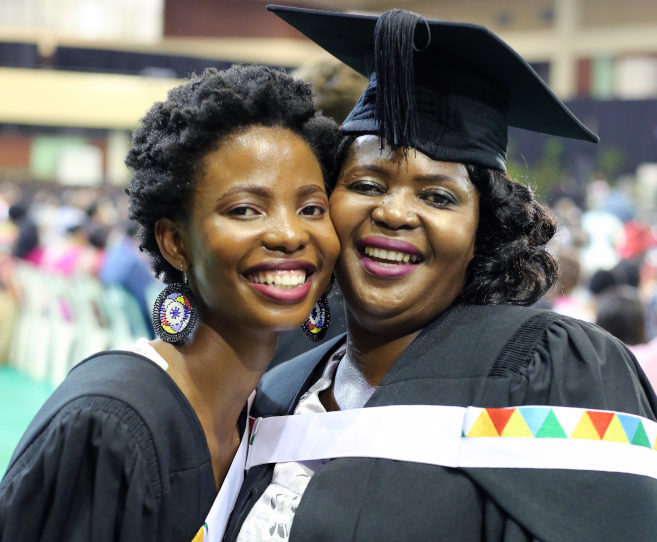 Proud Mom and Daughter Share Graduation Stage